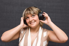 Girl in a headphones Royalty Free Stock Photo