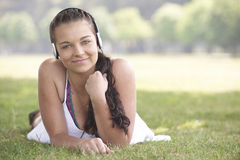 Girl and headphones Royalty Free Stock Photo