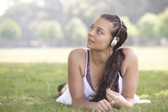 Girl and headphones Stock Photography