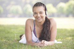 Girl and headphones Stock Photos