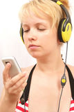 Girl with headphones. Beauty girl with headphones and player Stock Image
