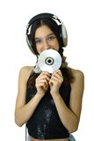 Girl with headphones. Teenager smiling girl with headphones listen music isolated over white Stock Images