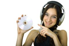 Girl with headphones. Teenager smiling girl with headphones listen music isolated over white Royalty Free Stock Image