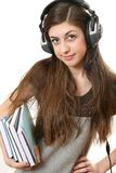The girl in headphones Stock Images