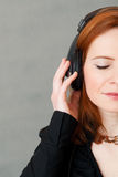 Half face portrait of red hair girl with headphones Royalty Free Stock Photos