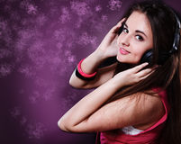 Girl with headphones. Portrait of a young girl with headphones on Stock Photos