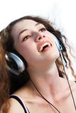 Girl in headphones 2. Girl in headphones on a white background stock images
