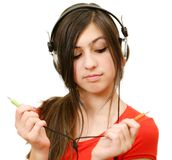 The girl in headphones Royalty Free Stock Images