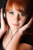 Girl in headphones. Stock Photos