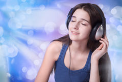 The girl in the headphones Stock Photo