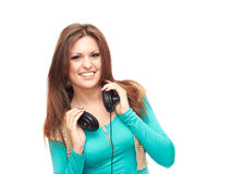 Girl with headphones. In a blue shirt on a white background Stock Image