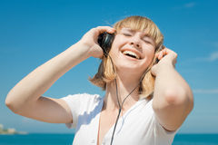 Girl in headphones Stock Image