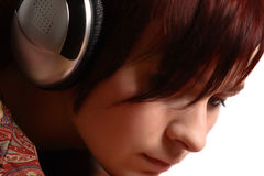 Girl in headphones. Close-up face of young girl with hwadphones Royalty Free Stock Photos