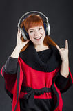 Girl with headphones. Over black background royalty free stock photo