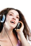 Girl in headphones 3. Girl in headphones on a white background royalty free stock images