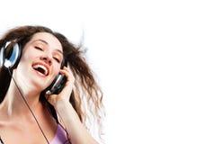 Girl in headphones 4 Stock Images