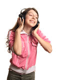The girl in headphones. The girl listens to music Royalty Free Stock Photo