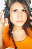 Girl with headphones. Close up stock photo