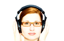 Girl in headphones. = Stock Photography