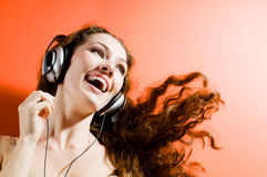 Girl in headphones royalty free stock photography