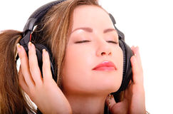 Girl in headphones Stock Images