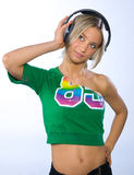 Girl with headphones. Listen some music Royalty Free Stock Image