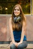 Girl with headphones Stock Photography
