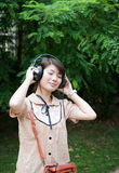 Girl with headphones. A Asian girl with headphones Stock Images