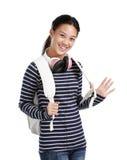 Girl with headphones and bag. Smiling teenage girl with headphones and bag Royalty Free Stock Photography