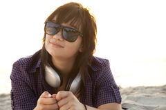 Girl with headphones at beach sand. Royalty Free Stock Images