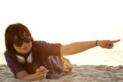 Girl with headphones at beach sand. Stock Images