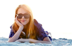 Girl with headphones at beach sand. Stock Photography