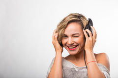 Girl in headphones Stock Images