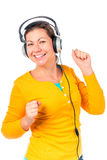 Girl in headphones  and dances Royalty Free Stock Images