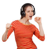 Girl with headphones dancing to music Stock Photos