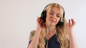 Girl with headphones dancing stock footage