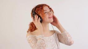 Girl with headphones dancing stock video footage