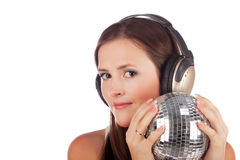 Girl in headphones and with a disco sphere Royalty Free Stock Photography