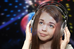 The girl in headphones on a disco Royalty Free Stock Photo