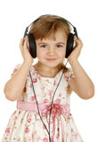 Girl in headphones enjoying music Royalty Free Stock Photography
