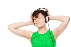 Girl in headphones enjoys classical music portrait Stock Photos