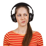 Girl with headphones expresses negative emotions Stock Images