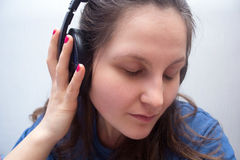 Girl with headphones with eyes closed Royalty Free Stock Image