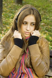 Girl with headphones fall Royalty Free Stock Photos