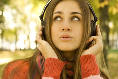 Girl with headphones fall Royalty Free Stock Images