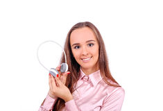 Girl with headphones in hand Stock Images