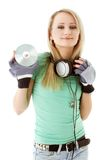 Girl with headphones holding cd Royalty Free Stock Photos