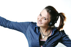 Girl with headphones isolated Stock Images