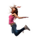Girl in headphones jumps Royalty Free Stock Photography