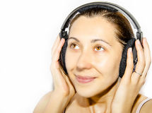 Girl in headphones. Lady Listening to Music with Headphones Royalty Free Stock Photography